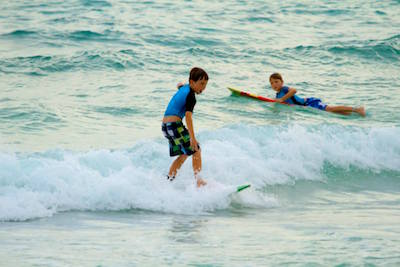 Kids have fun learning to surf Barbados